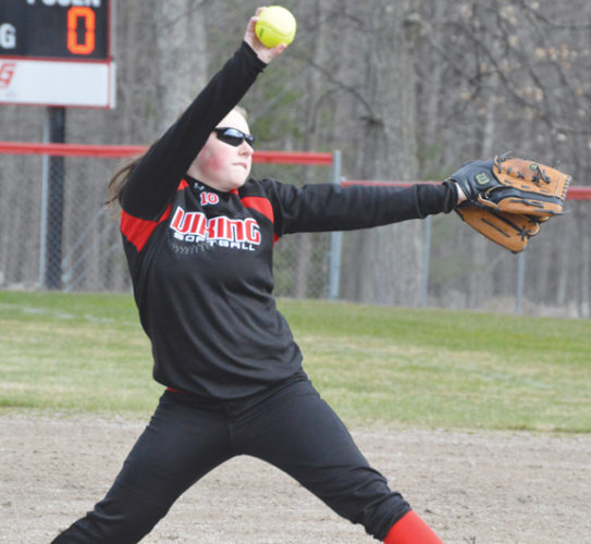 News Photo by James Andersen Posen pitcher Arianne Chojnacki winds up to throw during the first game of a doubleheader against Oscoda on Monday at Posen High School.
