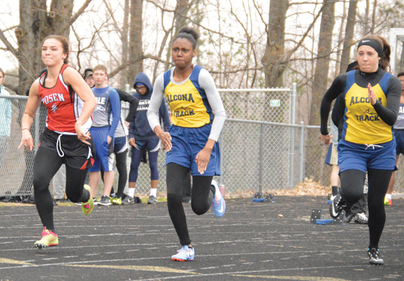 News Photo by James Andersen Posen's Lindsey Randall (left) and Alcona's Kameesha Fuqua (center) and Katherine Edwards race in a 100 dash heat during a North Star League meet at Alcona High School on Tuesday. Randall finished second in the event, Edwards was third and Fuqua was sixth.