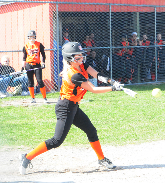 News Photo by Jonny Zawacki Hillman's Vanessa Schook hits an RBI single up the middle during the second inning in game one of a softball doubleheader on Wednesday against Whittemore-Prescott at Hillman High School.