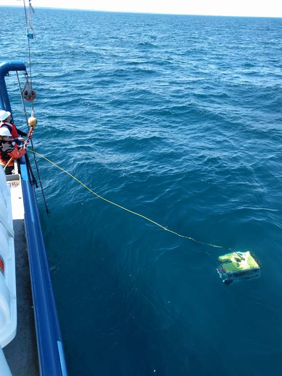 Courtesy Photo A crew member from the USGS Arcticus deploys a ROV while conducting a pilot survey in Thunder Bay earlier this week. The USGS is using new technology in the aim of better determining the biomass of gobies.