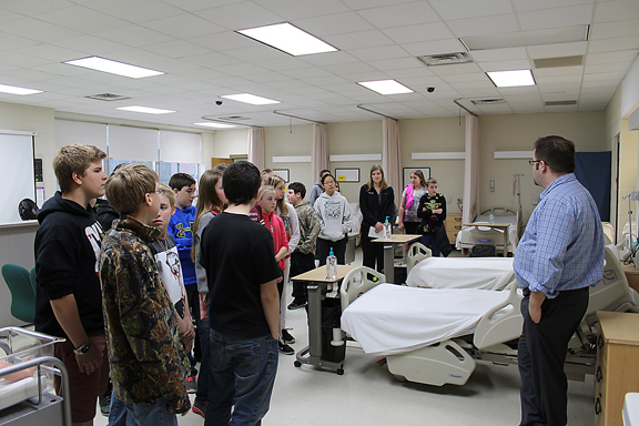 News Photo by Steve Schulwitz Alpena Community College nursing instructor Anthony Pratt explains the benefits of a career in nursing to Thunder Bay Junior High students during a showcase of the college Friday. There were about 300 seventh grade students who took part in the showcase.