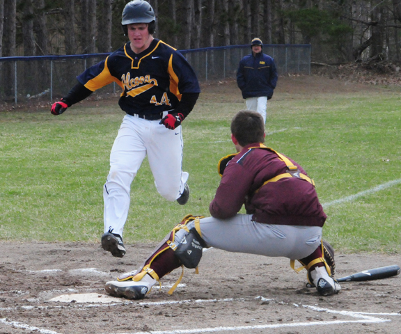 News Photo by Jonny Zawacki Alcona's Brock Franklin (44) beats out a throw to the plate to score a run during the first inning of game one of a baseball doubleheader on Friday at Alcona High School.