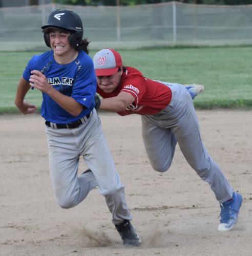 Photo by Seth Staskey / Elm Grove's Kasey Cassi is tagged out by Warwood second baseman James Francis after a brief rundown during the second inning of Friday's Mountaineer Pony League game at Warwood's Garden Park. Warwood rolled to a 13-1 victory.