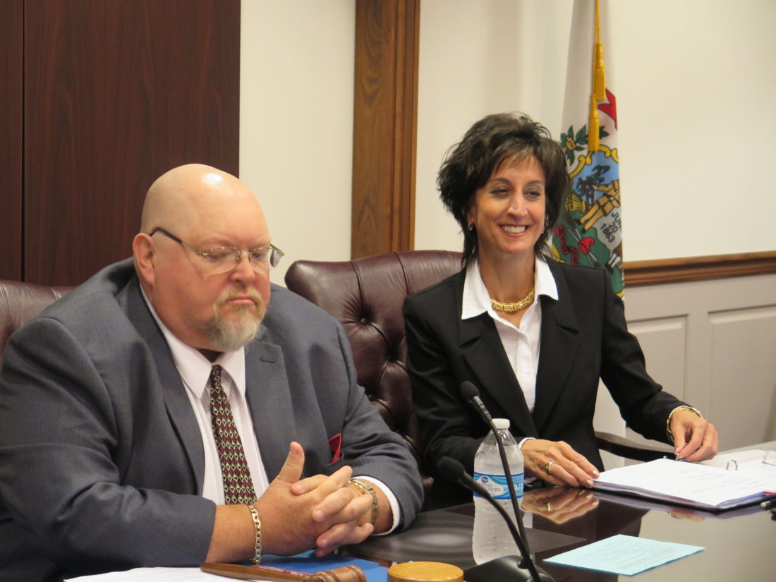 Photo by Joselyn King Ohio County Schools Superintendent Dianna Vargo sits down Monday for her last board of education meeting as superintendent alongside board member Tim Birch, who acted as board president.