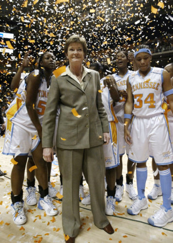 AP Photo / In this Jan. 14, 2003, file photo, Tennessee head coach Pat Summitt, center, smiles as she stands with her team after defeating DePaul, 76-57, to get her 800th career win, in Knoxville, Tenn.