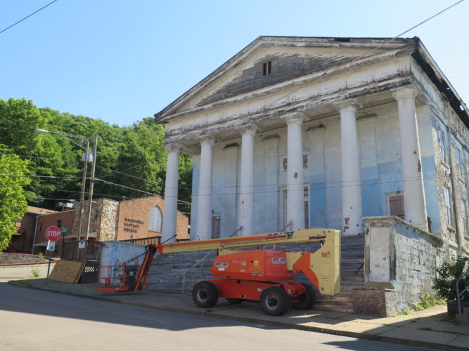 Photo by Alec Berry A construction truck is parked in front of the Blue Church in East Wheeling.