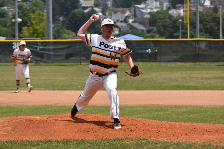 Photo by Kim North Post 1's Brian Shaw throws a pitch during Wheeling victory over The Shield on Friday.