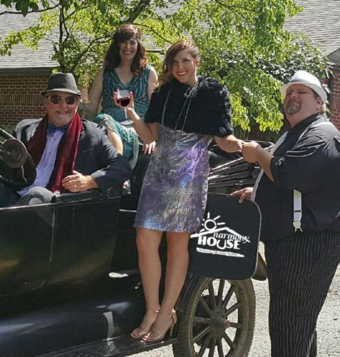 "Harmony House fundraising team members, from left, Chatman Neely, Leslie Vassilaros, Kayleen Fitzsimmons and Jay Jack, ""take the show on the road"" as they prepare to glam it up for the annual Toast of the Vineyard with a Tinseltown theme."