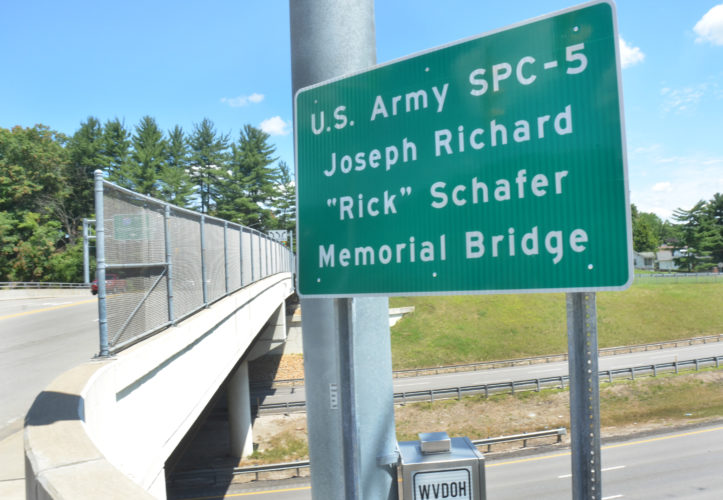 "Photo by Scott McCloskey The West Virginia Division of Highways recently posted signs at both ends of the Washington Avenue Bridge that crosses above Interstate 70 in Ohio County naming the bridge in honor of Army Spc. Joseph Richard ""Rick"" Schafer, who died while serving in Vietnam in 1971."