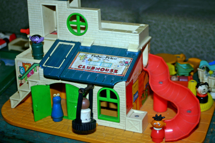 Fisher-Price created dozens and dozens of Playsets, like this Sesame Street Clubhouse complete with Little People from the 1970s.