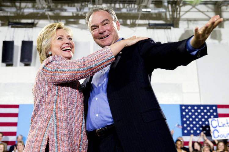In this July 14, 2016, file photo, Democratic presidential candidate Hillary Clinton, accompanied by Sen. Tim Kaine, D-Va., speaks at a rally at Northern Virginia Community College in Annandale, Va. Clinton has chosen Kaine to be her running mate (AP Photo/Andrew Harnik)