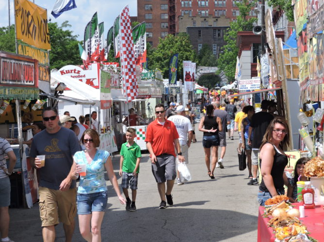 Photo by Alan Olson Upper Ohio Valley Italian Heritage Festival patrons handle the afternoon heat Saturday in downtown Wheeling.