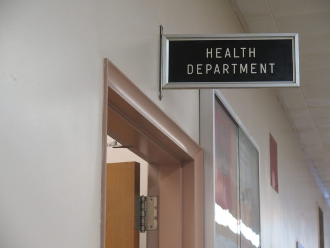 Photo by Alec Berry A sign hangs above the entrance of the Wheeling-Ohio County Health Department in the City-County Building.