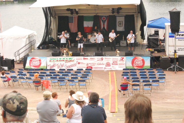 Photo by Alan Olson  The remaining crowd Sunday afternoon jams out to Legend in the last hours of the Upper Ohio Valley Italian Heritage Festival.