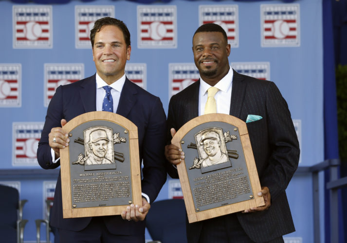 National Baseball Hall of Fame inductees Mike Piazza, left, and Ken Griffey Jr. hold their plaques after an induction ceremony at the Clark Sports Center on Sunday, July 24, 2016, in Cooperstown, N.Y. (AP Photo/Mike Groll)