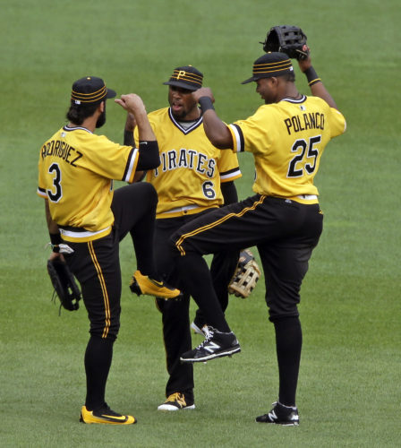 Pittsburgh Pirates outfielders Sean Rodriguez (3), Starling Marte (6), and Gregory Polanco (25) celebrate a 5-4 win over the Pittsburgh Pirates in a baseball game in Pittsburgh, Sunday, July 24, 2016. (AP Photo/Gene J. Puskar)
