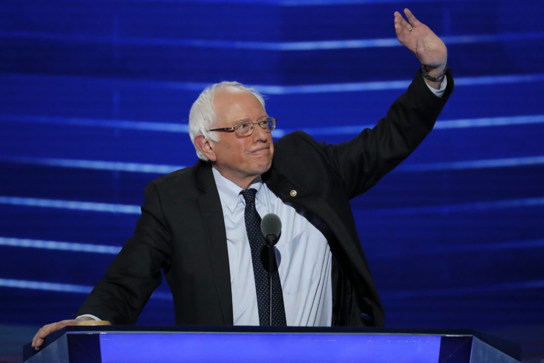 Former Democratic presidential candidate, Sen. Bernie Sanders, I-Vt., waves to delegates during the first day of the Democratic National Convention in Philadelphia , Monday, July 25, 2016. (AP Photo/J. Scott Applewhite)