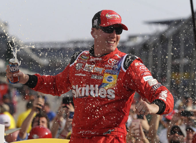 Kyle Busch celebrates after winning the Brickyard 400 NASCAR auto race at Indianapolis Motor Speedway in Indianapolis, Sunday, July 24, 2016. (AP Photo/Michael Conroy)
