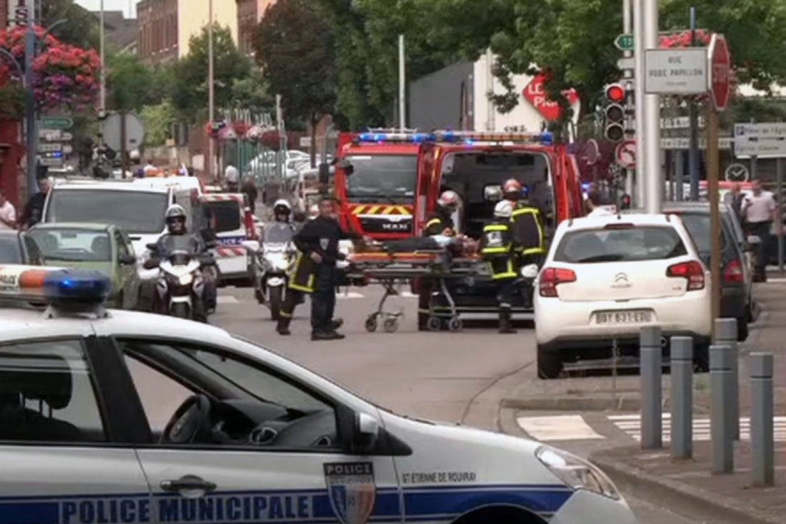 In this grab made from video, emergency services transport a person into a waiting ambulance in Normandy, France, Tuesday, July 26, 2016. Two attackers seized hostages in a church near the Normandy city of Rouen on Tuesday, killing one hostage by slitting their throat before being killed by police, a security official said. The identities of the attackers and motive for the attack are unclear, according to the official, who was not authorized to be publicly named. (BFM via AP)