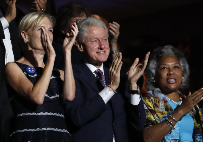 Former President Bill Clinton applauds Former Democratic Presidential candidate, Sen. Bernie Sanders, I-Vt., as he speaks during the first day of the Democratic National Convention in Philadelphia , Monday, July 25, 2016. (AP Photo/Paul Sancya)