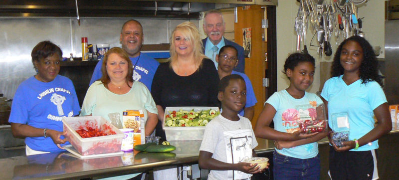 "Photo Provided - The Laughlin Chapel in Wheeling has been a recipient of funds from the ""Let's Start Fresh"" initiative to purchase fresh fruits and vegetables for its meal programs. Anticipating some of the fresh items they'll enjoy, from front left, are R.J. Wicks, Kabreya Askew and Breezie Askew, while Laughlin Chapel director the Rev. Marcia Allen, Wendy Tronka, the Rev. Danny Mason, Tina Carinci Morris, United Way Executive Director George Smoulder and Patty Mayfield look on."