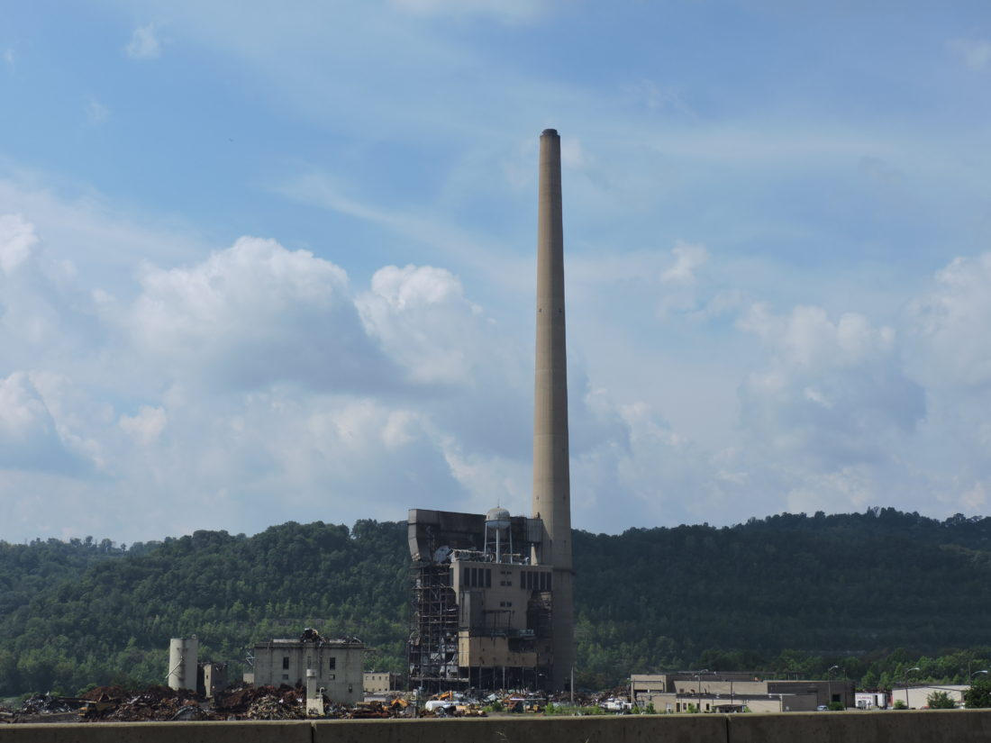 Photo by Casey Junkins FirstEnergy Corp. officials plan to demolish the 854-foot tall concrete smoke stack at the former R.E. Burger plant in Dilles Bottom around 8:30 a.m. Friday.