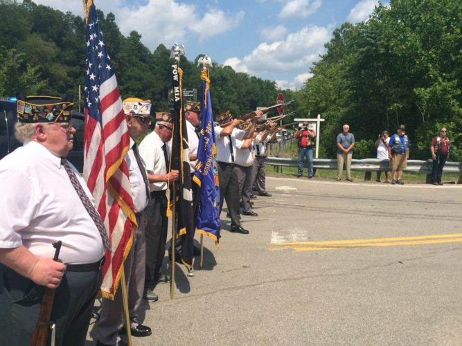 "Photo by Miles Layton The Blue Blazer Honor Guard from local American Legion posts and VFW members fires a salute and performs ""Taps"" at a bridge dedication ceremony in Tyler County honoring U.S. Army Cpl. Gary Wayne Weekley."