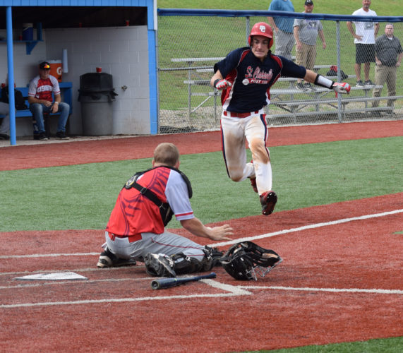 Photo by Kim North - St. Clairsville's Luke Slavik heads for home plate as Pickerington catcher Andrew Troup awaits the throw Thursday in the seventh inning of action during the Ohio American Legion state tournament at Beavers Field in Lancaster.