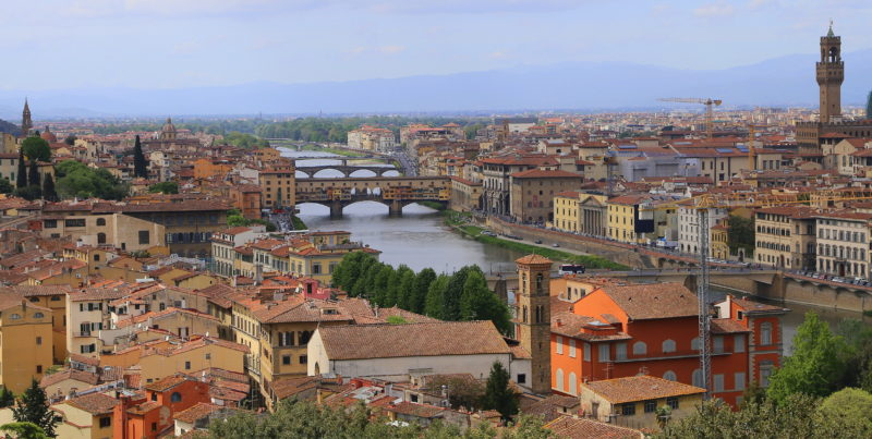 This photo taken April 18, 2016, shows the old city of Florence, Italy, flanking the River Arno as viewed from the Piazzale Michelangelo. The piazzale, a square in the hills above the city, is a great place to take in the views, especially at sunset. (Michelle Locke via AP)