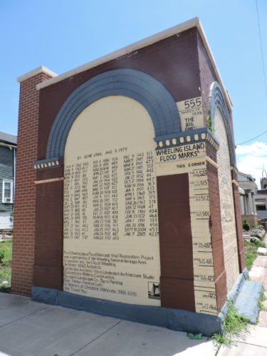 Photos by Jackie McDermott The Wheeling Island flood wall commemorates the island's many floods over the decades.