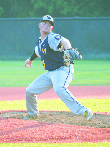 Photo by Kyle Lutz - Wheeling's Tyler Ashbrook throws a pitch during the seventh inning during Post 1's battle against Romney.