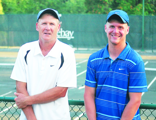 Photo by Cody Tomer - John Chatlak, left, and doubles teammate Jeremy McClelland pose for a photograph following a doubles match victory in Friday's Bordas and Bordas West Virginia Open at the Oglebay Tennis Club.