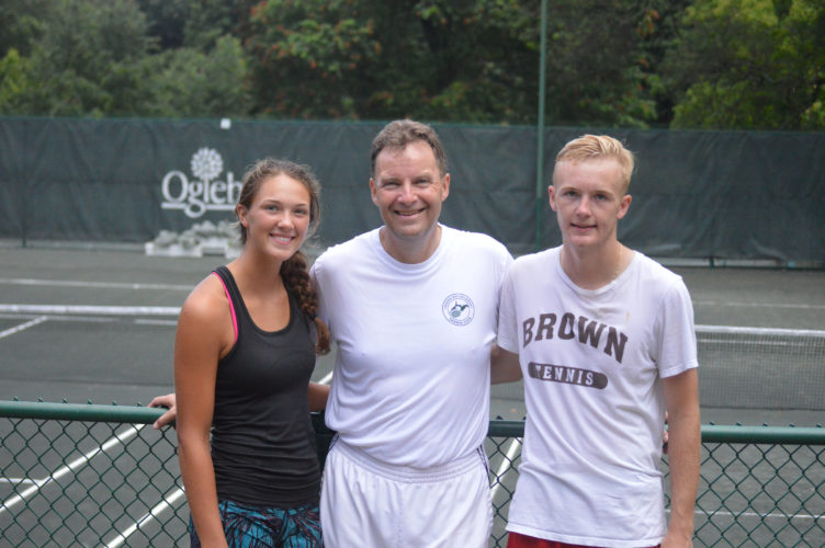 Photo by Cody Tomer The Sandberg family, Molly (left) Hugo (center) and Aaron (right) pose for a picture on Saturday at the Oglebay Tennis Facility.