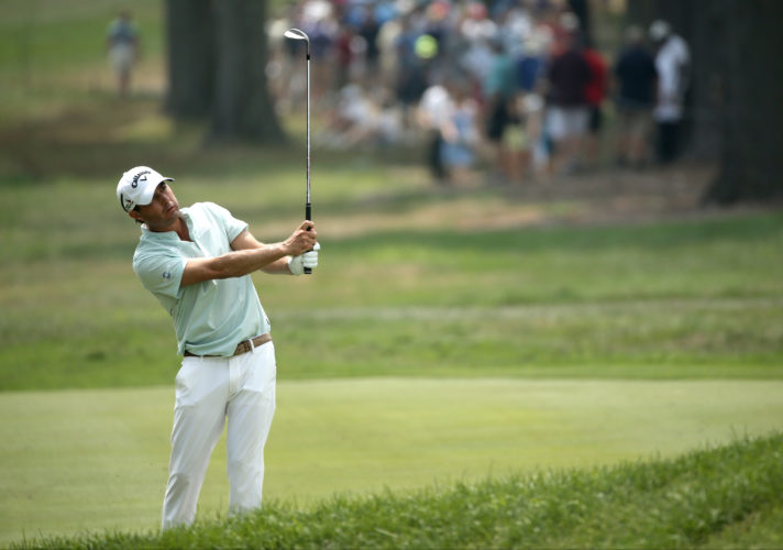 Kevin Kisner watches his approach shot to the 18th hole during the third round of the PGA Championship golf tournament at Baltusrol Golf Club in Springfield, N.J., Saturday, July 30, 2016. (AP Photo/Seth Wenig)