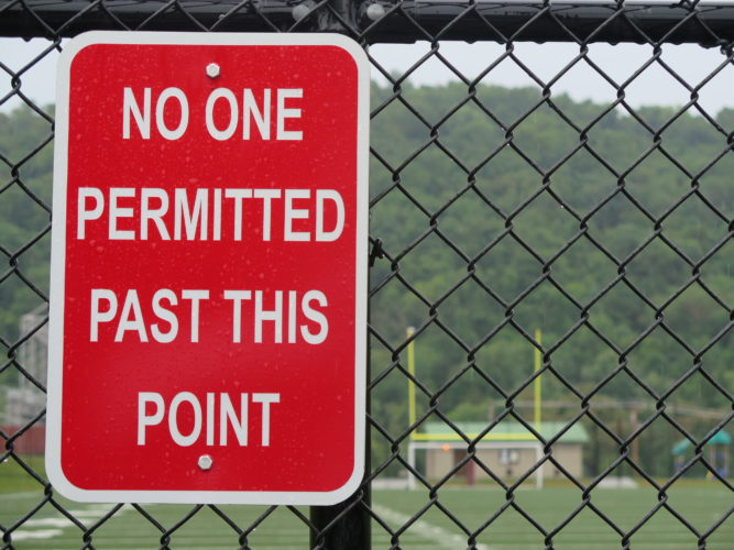 "Photo by  Alec Berry A sign advises visitors of ""no one"" being permitted beyond the fence and onto the field of the J.B.               Chambers Sports         Complex in East                Wheeling."