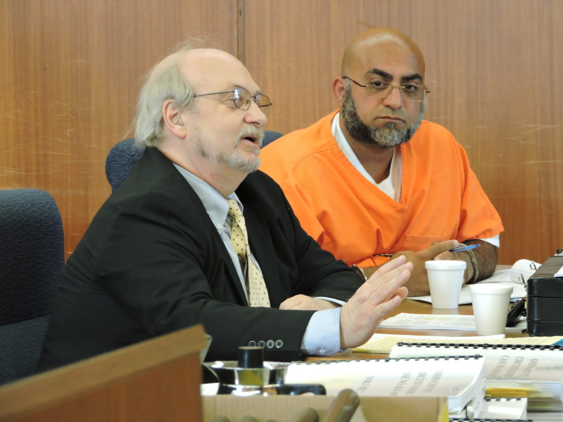 Photo by Kylie Weisenborn Convicted murderer Yassar Abdelhaq, right, appears in Ohio County Circuit Court Tuesday to ask for a new trial. With him is attorney Dana McDermott of Martinsburg.