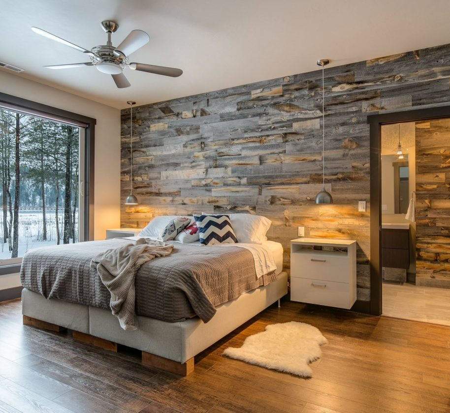 This undated photo provided by Stikwood shows a bedroom with a wood wall. Wood walls are a strong décor trend, and they're a far cry from the dowdy paneling of decades past. Reclaimed wood is sawn into thin planks that can be attached to walls using adhesive or adhesion strips ready for mounting directly out of the box. Weathered finishes as well as richly-toned smooth finishes are available, expanding the design options. (Marie-Dominique Verdier/Selle Valley Construction/Stikwood via AP)