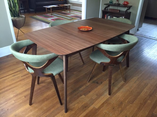 This photo taken on July 22, 2016 shows a mid-century modern inspired dining room table and chairs in a Pasadena, Calif., home. (Solvej Schou via AP)