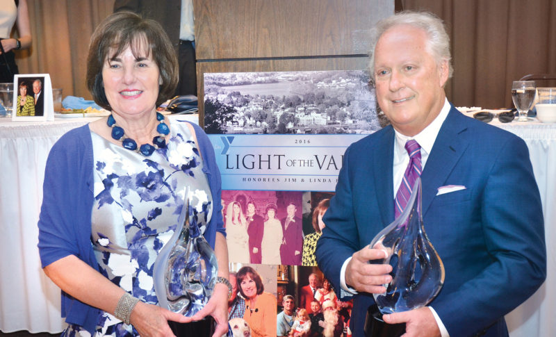 Photo by Scott McCloskey Linda and Jim Bordas are shown with their Dr. Lee Jones Patron of Youth awards during the Chambers YMCA Light of the Valley luncheon on Wednesday.