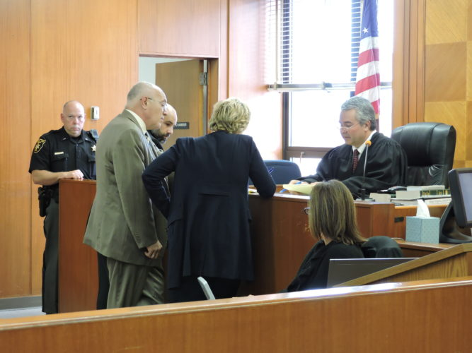 Photo by Kylie Weisenborn Richard William Zimmerman, center, and his attorney, Keith Hart, confer with Ohio County Assistant Prosecutor Shawn Turak during Zimmerman's trial Thursday.
