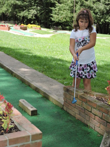 Photo by Casey Junkins Ashlan Sikora, 7, plays miniature golf at Wheeling Park.
