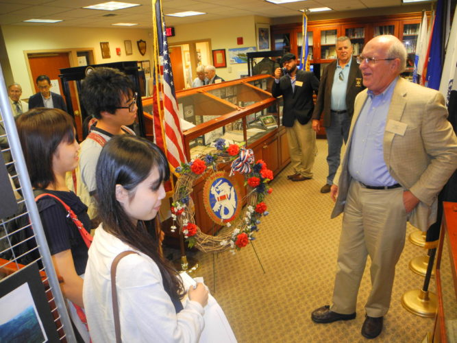 Photo by Warren Scott Students from Ritsumeikan University of Kyoto, Japan listen as Joe Vater Jr. discusses the experiences of his father, Joe Vater Sr., who shared a camera and photos he took following his release from a Japanese POW camp during World War II.