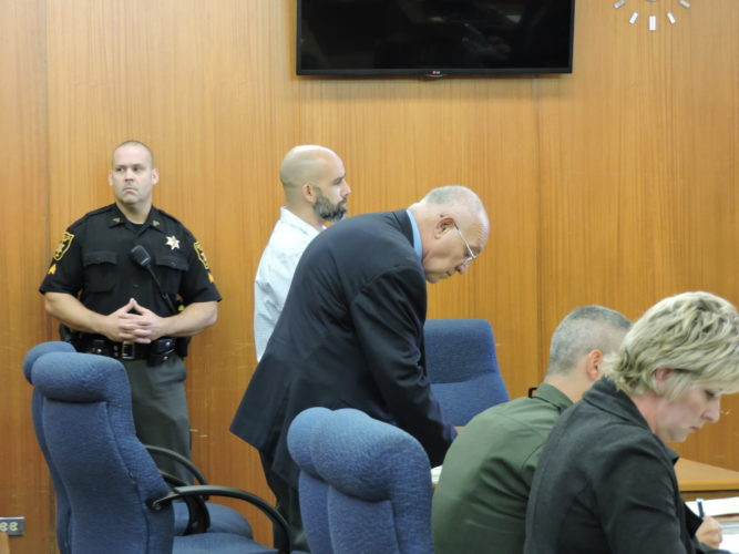 Photo by Kylie Weisenborn Richard Zimmerman, back, stands next to his attorney, Keith Hart, during Zimmerman's sexual abuse trial.