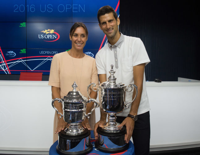 Reigning U.S. Open tennis champions Flavia Pennetta, left and Novak Djokovic, pose with their trophies during a media availability at the Billie Jean King National Tennis Center, Friday, Aug. 26, 2016, in New York. (AP Photo/Bryan R. Smith)