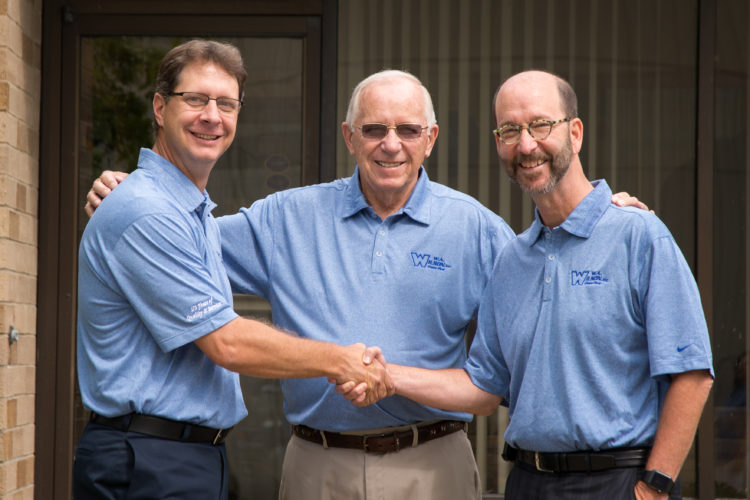 Photo Provided Robert Hartong II, left, Robert Hartong, center, and Steven Perilstein of W.A. Wilson Glass Plus pose for a photo outside the Wheeling  company's Fulton facility.