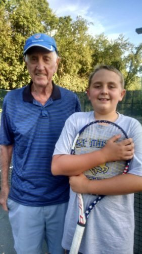 Jerry Mulhern, coach of Millie Mulhern Middle School Tennis since its inception in 2007, welcomes Wyatt Andrews, a seventh grader from St. Michael's, to the fall session which began Tuesday.