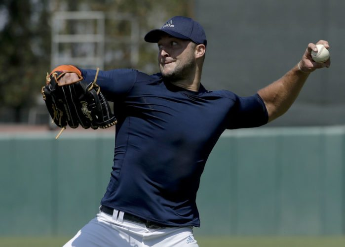 Former NFL quarterback, Tim Tebow throws a ball for baseball scouts and the media during a showcase on the campus of the University of Southern California, Tuesday, Aug. 30, 2016 in Los Angeles. The Heisman Trophy winner works out for a big gathering of scouts on USC's campus in an attempt to start a career in a sport he hasn't played regularly since high school. (AP Photo/Chris Carlson)