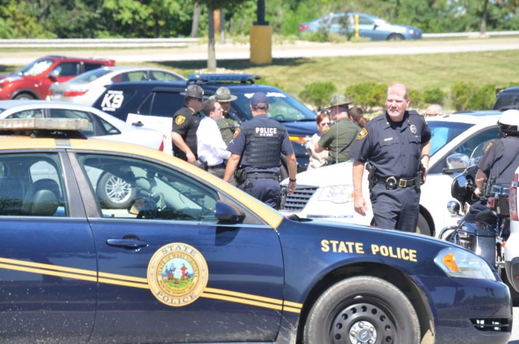 Photo by Scott McCloskey Several local law enforcement agencies descend on a parking lot near Wal-Mart at The Highlands Tuesday after a Wheeling police officer driving from Pennsylvania on Interstate 70 spotted a pickup truck that matched the description of a vehicle reportedly involved in the kidnapping of Tierne Ewing by her husband Kevin Ewing in Washington County, Pa. on Monday night. Although the vehicle was the same one mentioned in a Pennsylvania State Police bulletin, the two people inside were released after officers determined neither was the kidnapping suspect.