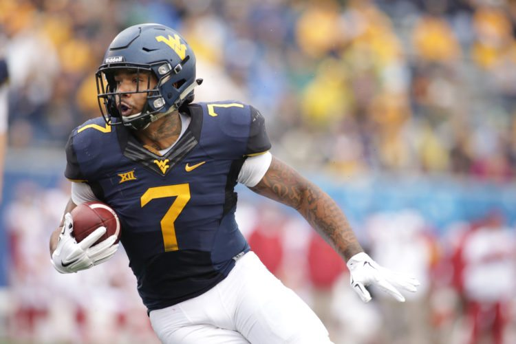 FILE - In this Nov. 28, 2015, file photo, West Virginia running back Rushel Shell (7) carries the ball during an NCAA college football game against Iowa State, in Morgantown, W.Va. Shell is expected to shoulder much of the Mountaineers' rushing responsibilities following the departure of Big 12 rushing leader Wendell Smallwood, and his quest for an elusive 1,000-yard season starts in Saturday's season opener against Missouri. (AP Photo/Raymond Thompson, File)