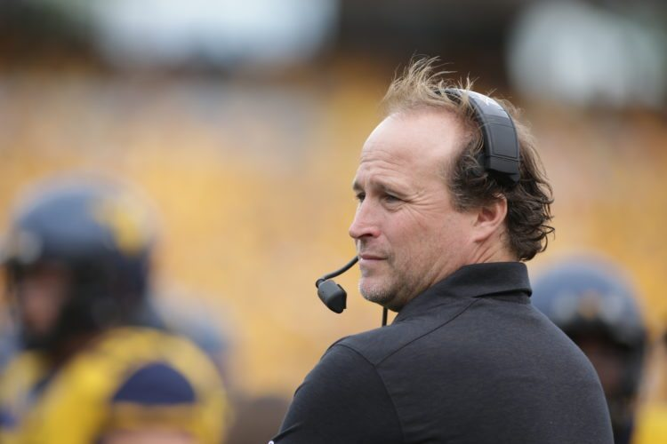 FILE - In this Sept. 26, 2015, file photo, West Virginia coach Dana Holgorsen watches his team play Maryland in an NCAA college football game in Morgantown,  W.Va.  Even after an 8-5 finish and a bowl victory last season, new athletic director Shane Lyons pondered making a change. More of the same might not be enough for Holgorsen. (AP Photo/Raymond Thompson)